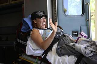 """ENGLEWOOD, CO - JUNE 18: Amy Van Dyken-Rouen waves as she arrives at Craig Hospital after leaving Scottsdale Healthcare Osborne Medical Center June 18, 2014 by Angel MedFlight. Amy will join approximately 40 other inpatients with her type of injury from around the U.S. currently undergoing the specialized SCI rehabilitation at Craig. Amy will have a SCI """"Interdisciplinary"""" Team, a physician, rehab nurses and rehab nurse technicians, physical therapist, occupational therapist, clinical psychologist, therapeutic recreation specialist, dietician, clinical care manager, and others. (Photo by John Leyba/The Denver Post)"""