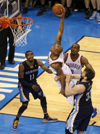 Oklahoma City's Caron Butler (2) goes by Memphis' Marc Gasol (33) for a dunk as Mike Conley (11) and Oklahoma City's Serge Ibaka (9) watch during Game 1 in the first round of the NBA playoffs between the Oklahoma City Thunder and the Memphis Grizzlies at Chesapeake Energy Arena in Oklahoma City, Saturday, April 19, 2014. Photo by Nate Billings, The Oklahoman