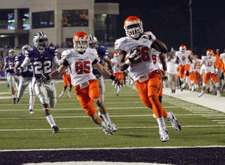 Oklahoma State's Desmond Roland (26) scores a touchdown on a kickoff return during the college football game between Kansas State University (KSU) and Oklahoma State (OSU) at Bill Snyder Family Football Stadium in Manhattan, Kan., Saturday, Nov. 3, 2012. Photo by Sarah Phipps, The Oklahoman