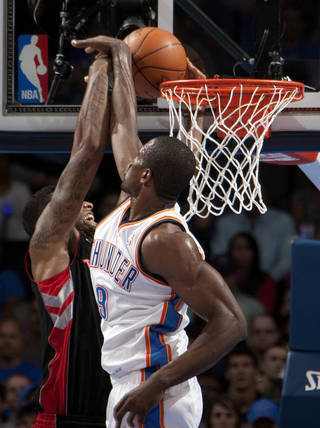 Oklahoma City's Serge Ibaka (9) blocks the shot of a Toronto's player during the NBA basketball game between the Oklahoma City Thunder and the Toronto Raptors at Chesapeake Energy Arena in Oklahoma City, Sunday, April 8, 2012. Photo by Sarah Phipps, The Oklahoman.