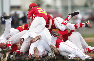 Dale players celebrate their championship win by forming a human pile on the pitcher's mound after pitcher Evan Anderson struck out the last batter to end the Class 2A state high school baseball championship game at Shawnee High School's Memorial Park. on Saturday,, May 12, 2012. Dale shut-out the Silo Rebels, 11-0 after 6 innings. Photo by Jim Beckel, The Oklahoman