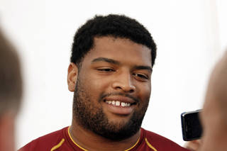 FILE - This Aug. 2, 2012 file photo shows Washington Redskins offensive tackle Trent Williams smiling as he speaks during a media availability after practice at NFL football training camp at Redskins Park in Ashburn, Va. A year ago, Williams' four-game suspension put him on the list of Redskins who were contributing to a losing culture. He has since worked tirelessly to rehabilitate himself on and off the field to and get himself off that list, playing through pain for a team that's now winning. (AP Photo/Alex Brandon, File) ORG XMIT: NY162