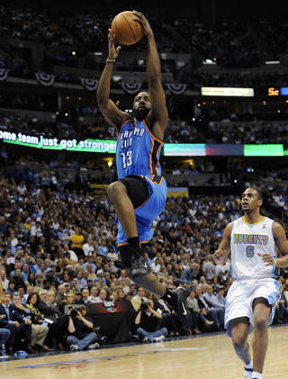 Oklahoma City Thunder guard James Harden (13) breaks away for a dunk against Denver Nuggets guard Arron Afflalo (6) during the first half of game 3 of a first-round NBA basketball playoff series Saturday, April 23, 2011, in Denver. (AP Photo/Jack Dempsey)