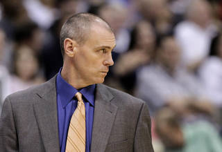 Dallas Mavericks head coach Rick Carlisle watches from the bench late in the second half of an NBA basketball game against the Golden State Warriors, Friday, April 20, 2012, in Dallas. The Mavericks won 104-94. (AP Photo/Tony Gutierrez) ORG XMIT: DNA113