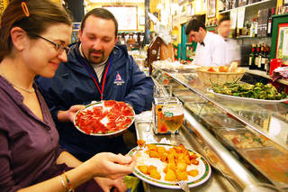 Making a meal of tasty tapas — available in bars throughout the day — is the perfect solution for travelers who can't wait until 9 or 10 p.m. for dinner. Photo by Rick Steves