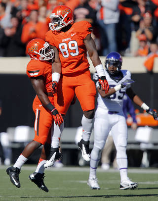 Oklahoma State's Shaun Lewis (11) and Sam Wren (89) celebrate a defensive stop during a college football game between the Oklahoma State University Cowboys (OSU) and the Texas Christian University Horned Frogs (TCU) at Boone Pickens Stadium in Stillwater, Okla., Saturday, Oct. 19, 2013. Photo by Chris Landsberger, The Oklahoman