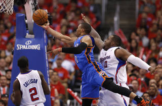Oklahoma City's Russell Westbrook (0) goes to the basket between Los Angeles' Darren Collison (2) and Glen Davis (0) during Game 6 of the Western Conference semifinals in the NBA playoffs between the Oklahoma City Thunder and the Los Angeles Clippers at the Staples Center in Los Angeles, Thursday, May 15, 2014. Photo by Nate Billings, The Oklahoman