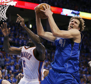 Dallas' Dirk Nowitzki (41) grabs a rebound next to Oklahoma City's Kendrick Perkins (5) late in the fourth quarter during game one of the first round in the NBA playoffs between the Oklahoma City Thunder and the Dallas Mavericks at Chesapeake Energy Arena in Oklahoma City, Saturday, April 28, 2012. Oklahoma City won, 99-98. Photo by Nate Billings, The Oklahoman