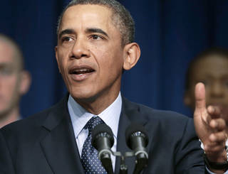 President Barack Obama speaks about the sequester Tuesday, as he stands with emergency responders, a group of workers the White House says could be affected as a result of budget cuts. AP Photo