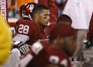 Oklahoma's Travis Lewis (28) sits on the bench during the college football game between the University of Oklahoma Sooners (OU) and the Texas Tech University Red Raiders (TTU) at Gaylord Family-Oklahoma Memorial Stadium in Norman, Okla., Sunday, Oct. 23, 2011. Oklahoma lost 38-41. Photo by Bryan Terry, The Oklahoman
