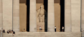 Labor Day weekend visitors gather at the Lincoln Memorial at sunrise in Washington, Sunday, Sept. 6, 2009. (AP Photo/J. Scott Applewhite)