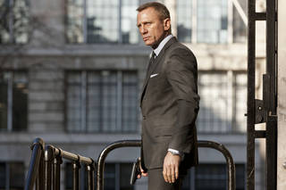 "Daniel Craig as James Bond, with his trusty Walther PPK in hand in the action thriller ""Skyfall."" SONY PICTURES PHOTO"