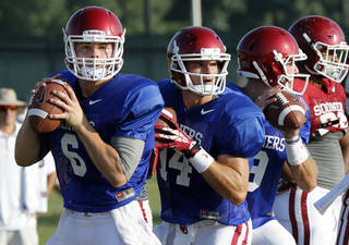 Quarterbacks Baker Mayfield, Cody Thomas and Trevor Knight go through drills during the University of Oklahoma Sooners (OU) football practice at the rugby fields in Norman, Okla., on Tuesday, Aug. 5, 2014. Photo by Steve Sisney, The Oklahoman
