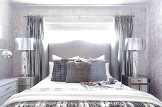 This publicity photo shows a guest bedroom by Designer Brian Patrick Flynn for HGTV.com that turns to wintry menswear for inspiration when creating wintry spaces. It includes a custom headboard made from men's suiting fabric featuring a check print, as well as pillows made from hand-me-down sweaters and flannel shirts. (AP Photo/Brian Patrick Flynn for HGTV.com, Daniel J. Collopy)