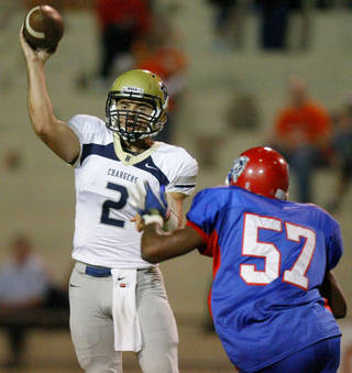 Heritage Hall's Quinn Shanbour throws during a high school football game against John Marshall at Taft Stadium in Oklahoma City, Thursday, Oct. 13, 2011, Photo by Bryan Terry, The Oklahoman ORG XMIT: KOD