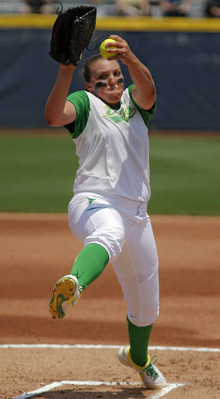 Oregon's Cheridan Hawkins throws a pitch during the Women's College World Series softball game between Florida State and Oregon at ASA Hall of Fame Stadium on Thursday, May 29, 2014 in Oklahoma City, Okla. Photo by Chris Landsberger, The Oklahoman