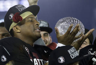 FLORIDA STATE * Coach: Jimbo Fisher * 2013 model: Final BCS champ * Strengths: Heisman-winning QB Jameis Winston, pictured with the BCS trophy, and a veteran offensive line * Weaknesses: Lost five starters on offense and five starters on defense * Key dates: Clemson (Sept. 20), Notre Dame (Oct. 18) and Florida (Nov. 29 all come to Tallahassee * Outlook: Loaded roster, advantageous schedule should get Seminoles into semifinals. PHOTO BY THE ASSOCIATED PRESS