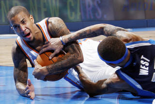 Oklahoma City's Eric Maynor (6) and Delonte West (13) of Dallas battle for the ball in the second half during an NBA basketball game between the Oklahoma City Thunder and the Dallas Mavericks at Chesapeake Energy Arena in Oklahoma City, Thursday, Dec. 29, 2011. Oklahoma City won, 104-102. Photo by Nate Billings, The Oklahoman