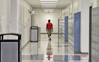 A student walks the hallway at John Marshall High School on Friday, March 30, 2012, in Oklahoma City, Okla. Photo by Chris Landsberger, The Oklahoman