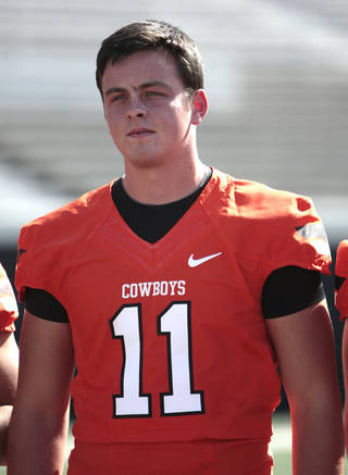 OKLAHOMA STATE UNIVERSITY / OSU / COLLEGE FOOTBALL: Quarterback Wes Lunt has his picture taken during Oklahoma State's football media day in Stillwater, Okla., Saturday, Aug. 4, 2012. Photo by Sarah Phipps, The Oklahoman