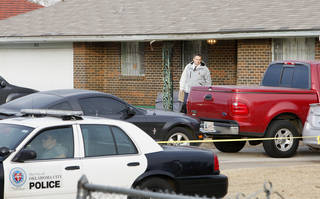 Left: Oklahoma City police investigate an early morning homicide Monday at 1215 NE 46. Photo by Paul B. Southerland, The Oklahoman