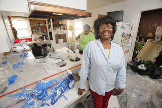 Eunice Russell is happy with the work being done at her home at 2521 NE 14th St. in Oklahoma City during Rebuilding Together. Photo By Paul Hellstern, The Oklahoman