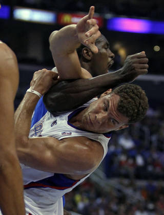 Oklahoma City Thunder forward Serge Ibaka, top, of Congo, tangles with Los Angeles Clippers forward Blake Griffin, right, in the first half of their NBA basketball game Wednesday, Nov. 13, 2013, in Los Angeles. A scuffle ensued causing Ibaka and Clippers forward Matt Barnes (not pictured) to be ejected from the game. (AP Photo/Alex Gallardo)