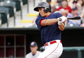 Oklahoma City RedHawks designated hitter George Springer hits during a minor league baseball game at Chickasaw Bricktown Ballpark between the Oklahoma City RedHawks and the Reno Aces on July 30, 2013. Photo by KT KING, The Oklahoman