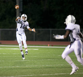 Casady quarterback T'Quan Wallace (12) throws a touchdown pass during high school football action between OKC Casady at Holland Hall on August 29, 2014. JOEY JOHNSON/For the Tulsa World