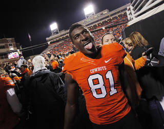 REACTION: OSU's Justin Blackmon (81) reacts as he leaves the field after the Bedlam college football game between the Oklahoma State University Cowboys and the University of Oklahoma Sooners at Boone Pickens Stadium in Stillwater, Okla., Saturday, Dec. 3, 2011. OSU beat OU, 44-10. Photo by Nate Billings, The Oklahoman