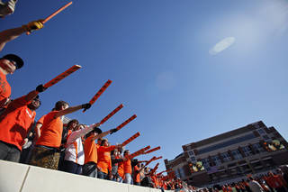 Oklahoma State fans cheer for their Cowboys during the college football game between the Oklahoma State University Cowboys (OSU) and the Baylor University Bears at Boone Pickens Stadium in Stillwater, Okla., Saturday, Nov. 6, 2010. Photo by Chris Landsberger, The Oklahoman
