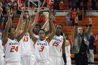 Oklahoma State cheers following an NCAA college basketball game against Coppin State in Stillwater, Okla., Saturday, Nov. 26, 2011. Oklahoma State won 59-35. (AP Photo/The Oklahoman, Sarah Phipps) ORG XMIT: OKOKL209