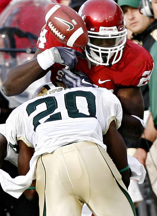 Baylor's Clifton Odom (20) breaks up a pass for Oklahoma's Dejuan Miller (24) during the second half of OU's 33-7 win over Baylor Saturday. Photo by Chris Landsberger, The Oklahoman.