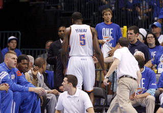 Oklahoma City's Kendrick Perkins (5) walks off the court after an injury during Game 1 in the second round of the NBA playoffs between the Oklahoma City Thunder and L.A. Lakers at Chesapeake Energy Arena in Oklahoma City, Monday, May 14, 2012. Oklahoma City won 119-90. Photo by Bryan Terry, The Oklahoman