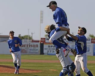 Berryhill's Zach Jackson, center, leaps towards Nick White as R.J. Stout, at right, follows as they celebrate their win over Plainview in the Class 4A state baseball tournament championship game in Shawnee, Okla., Saturday, May 11, 2013. Photo by Bryan Terry, The Oklahoman