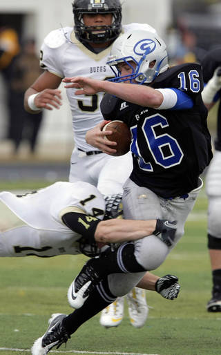 CLASS 5A HIGH SCHOOL FOOTBALL PLAYOFFS: McAlester's Adam Boyd tackles Guthrie quarterback Bryan Dutton as Devin Rolan chases in the 2nd half of their 5A semifinal game at Sapulpa, OK, Nov. 26, 2011. MICHAEL WYKE/Tulsa World ORG XMIT: DTI1111261921322138