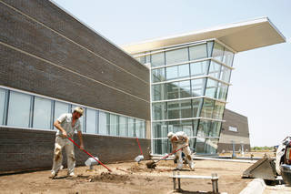 Larry Farnsworth and Cole Athay of Design Plus work outside on the landscaping of the new Oklahoma City Thunder NBA basketball team practice facility on Monday, June 13, 2011. Photo by Zach Gray, The Oklahoman ORG XMIT: KOD
