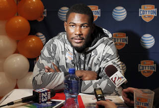 Oklahoma State junior running back Desmond Roland speaks to the media during an NCAA college football press conference, Wednesday, Jan. 1, 2014, in Irving, Texas. Oklahoma State takes on Missouri in the Cotton Bowl on Friday in Arlington, Texas. (AP Photo/Brandon Wade)