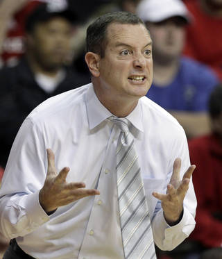 FILE - In this Jan. 7, 2012, file photo, Rutgers coach Mike Rice reacts to play during an NCAA college basketball game against Connecticut in Piscataway, N.J. The airing Tuesday, April 2, 2013, of a videotape of Rice using gay slurs, shoving and grabbing his players and throwing balls at them in practice over the past three seasons has Rutgers athletic director Tim Pernetti reconsidering his decision not to fire the coach. Pernetti was given a copy of the video in late November by a disgruntled former employee, and he suspended Rice for three games, fined him $50,000 and made him undergo anger management classes for inappropriate behavior after investigating it. (AP Photo/Rich Schultz, File)(AP Photo/Mel Evans, File) ORG XMIT: NY175