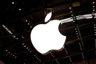 The Apple logo is seen hanging inside the Apple store on W 66th Street in New York City. Photo by Andrew Burton, Getty Images Andrew Burton - Getty Images