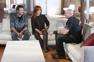 """From left, Oklahoma country music stars Blake Shelton and Reba McEntire give advice to """"The Voice"""" contestant Jared Blake on the set of the hit NBC TV show. Shelton is starring as one of the four celebrity coaches on the show. Photo by Lewis Jacobs/NBC Lewis Jacobs"""