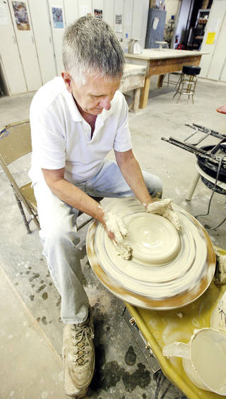 George Slosky, of Arcadia, uses a pottery wheel to make a plate during an advanced ceramics class at the Oklahoma Contemporary Art Center. Photo by Paul B. Southerland, The Oklahoman PAUL B. SOUTHERLAND - PAUL B. SOUTHERLAND