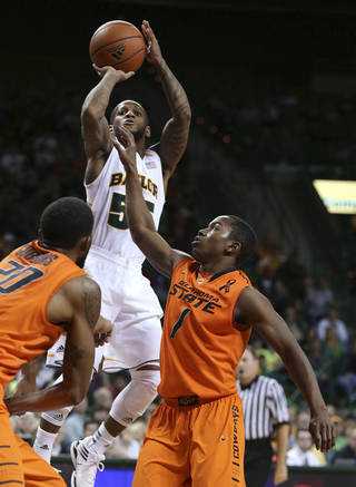 Baylor's Pierre Jackson (55) shoots over Oklahoma State's Michael Cobbins, left, and Kirby Gardner during the second half of an NCAA college basketball game, Monday, Jan. 21, 2013, in Waco, Texas. Baylor won 64-54. (AP Photo/Waco Tribune Herald, Rod Aydelotte) ORG XMIT: TXWAC108