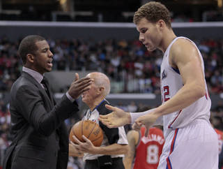 Los Angeles Clippers guard Chris Paul, left, celebrates with forward Blake Griffin after defeating the New Jersey Nets 101-91 in an NBA basketball game, Monday, Jan. 16, 2012, in Los Angeles. Paul sat out with a strained left hamstring. (AP Photo/Jason Redmond) ORG XMIT: LAS110