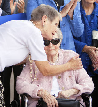 Patience S. Latting receives a hug from former employee Fran Cory during the opening of the new library.