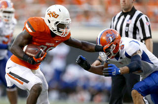 Oklahoma State's Desmond Roland (26) gets by Vaughn Cornelia (9) during a college football game between Oklahoma State University (OSU) and Savannah State University at Boone Pickens Stadium in Stillwater, Okla., Saturday, Sept. 1, 2012. Photo by Sarah Phipps, The Oklahoman