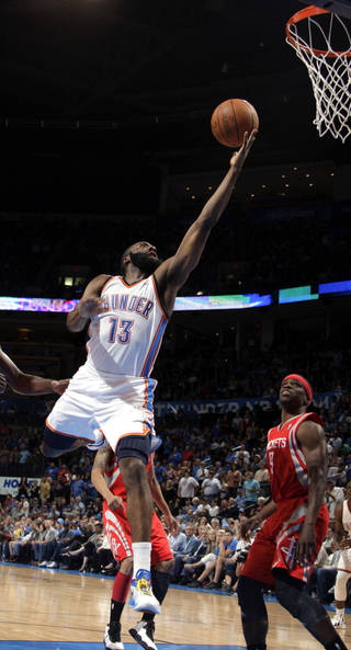 Oklahoma City's James Harden (13) shoots a lay up in front of Houston's Jonny Flynn (9) during the NBA basketball game between the Oklahoma City Thunder and the Houston Rockets at the Chesapeake Energy Arena, Tuesday, March 13, 2012. Photo by Sarah Phipps, The Oklahoman.