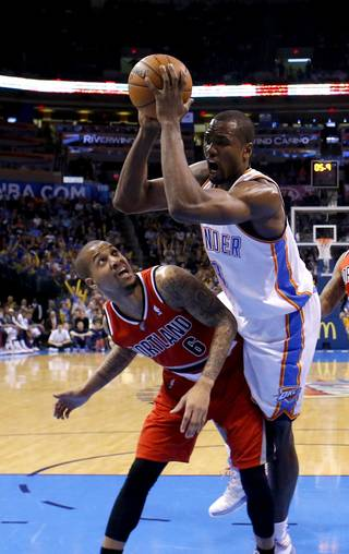 Oklahoma City's Serge Ibaka (9) is fouled by Portland's Eric Maynor (6) during the NBA basketball game between the Oklahoma City Thunder and the Portland Trail Blazers at the Chesapeake Energy Arena in Oklahoma City, Sunday, March, 24, 2013. Photo by Sarah Phipps, The Oklahoman