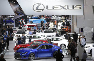 People walk around the Lexus display Jan. 14 at the North American International Auto Show in Detroit. AP Photo Carlos Osorio - AP