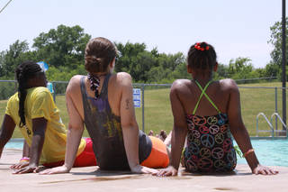 Children relax with a camp counselor by the pool at Harvest Foster Kids Camp, which is held each summer at Church of the Harvest, 6800 N Bryant Ave. Photo Provided Photographer:;Amber Wilkes